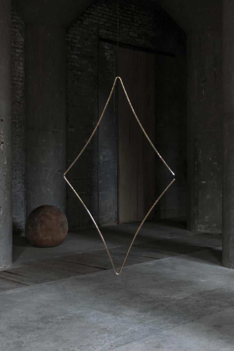 "Germaine Kruip (°Castricum, 1970), ""1.618 Rhombus, Brass (Thein n°3633)"", 2021, Polished brass rhombus and beater, unique engraved Thein Brass code, 150 x 75 x 2 cm"