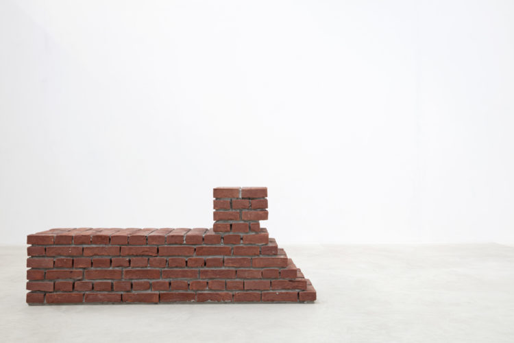 Installation view of 'Læsø XV (Chaise Loungue)'by Per Kirkeby during 'Brick Sculptures' at Axel Vervoordt Gallery