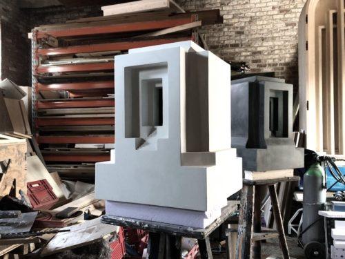 Renato Nicolodi, Monument II, 2021, black concrete, 35 x 35 x 46 cm, edition of 5; and Monument III, 2021, white concrete, 35 x 35 x 473 cm, edition of 5
