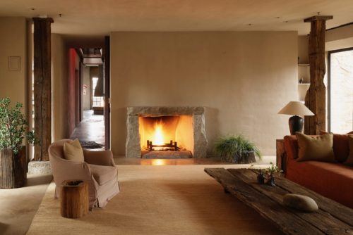 A stone fireplace offers warmth and atmosphere in a sitting room in TriBeCa