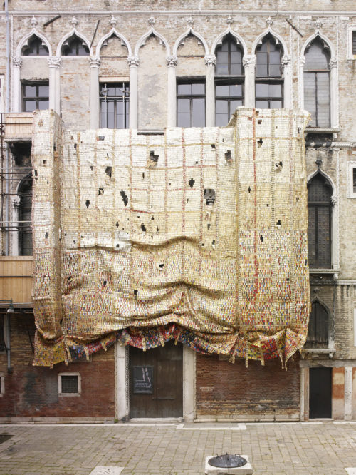 Installation view of El Anatsui's work on the Fortuny façade