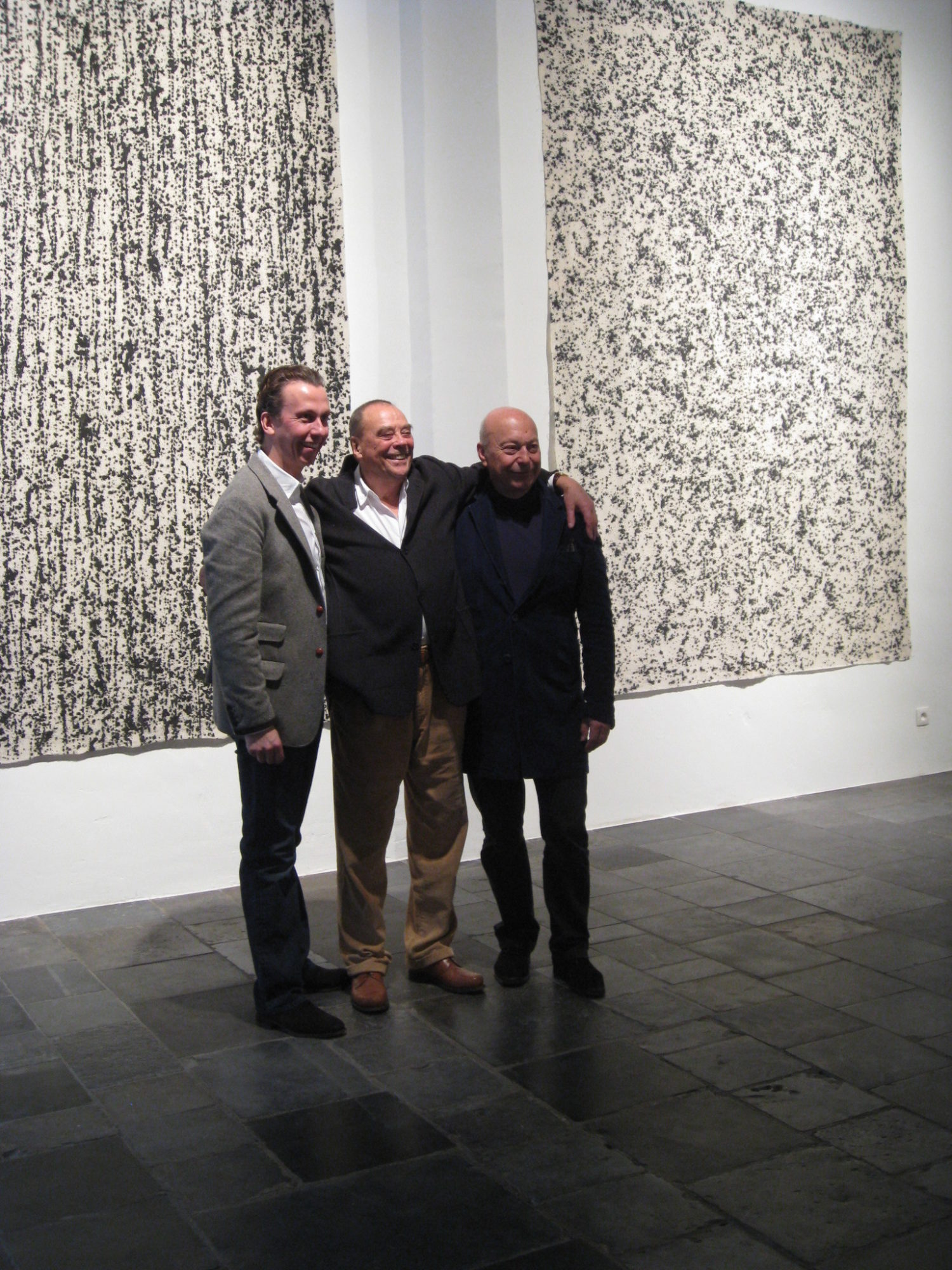 Boris Vervoordt, Günther Uecker, Axel Vervoordt stand if front of Uecker's work at the gallery in 2011.